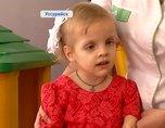 Девочка из Уссурийска с патологией рук едет с приемными родителями в Германию