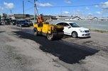В Уссурийске продолжаются работы по ямочному ремонту дорог